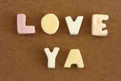 Love Ya. Spelled in pastel colour alphabet sweets Stock Photo