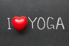 Love yoga. I love yoga phrase handwritten on chalkboard with heart symbol Stock Image