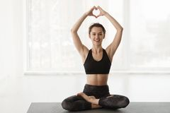 Love Yoga. Woman In Lotus Position Over Window royalty free stock photography