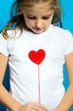 Love for you. Girl keeping a red heart like a concept for love of Valentine holiday and mother´s day Royalty Free Stock Photos