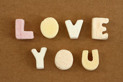 Love You. Spelled in pastel colour alphabet sweets royalty free stock photography