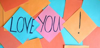Love you. Papers with a love you note royalty free stock image