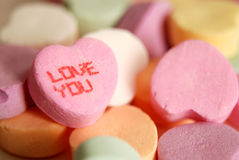 LOVE YOU. Candy, a simple illustration of love and romance, isolated by shallow depth of field Stock Photo