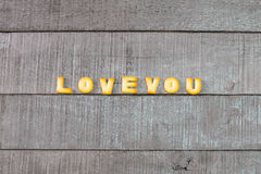 Love you alphabet biscuit on wooden Royalty Free Stock Image