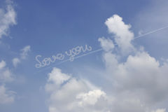LOVE YOU from the Beautiful Cloudy sky background. Stock Photography