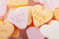 Love you candy hearts. Many candy hearts with text and love you royalty free stock image