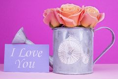Love you card with bouquet of roses. Bright roses in a decorative bailer. Greeting card for woman royalty free stock image