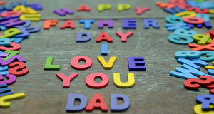 Love you dad, happy father day. I love you dad message for father, group of colourful letters to happy father day, wooden alphabet wood background Royalty Free Stock Image