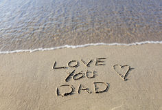 Love you dad written on the beach. Fathers day. Stock Image