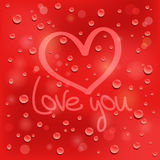 Love you. Drawn heart on the wet glass. Red backgr Stock Photo