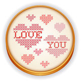 Love You Embroidery, Wood Sewing Hoop. Retro wood embroidery hoop with cross stitch needlework sewing design sampler, Love You with big red and pink hearts Stock Images