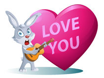 Love you. Funny rabbit playing guitar and singing a song on the. Love you. Funny rabbit playing guitar on the background of big heart. Cartoon styled vector Royalty Free Stock Image