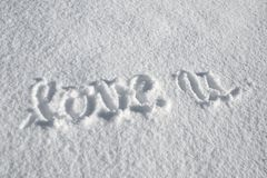 Love you message in the snow Royalty Free Stock Image