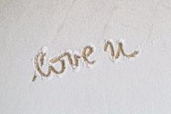 Love you handwritten in snow on orange floor Stock Image