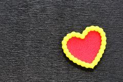 Love you. Heart with yellow trim on black textured background. Room for customised text Royalty Free Stock Photography
