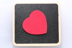 Love you. Large red heart on black board background. Room for customised text Royalty Free Stock Photo