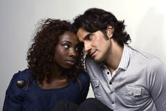 Love you Love Diversity. A loving couple expressing their emotions through their eyes Stock Photo