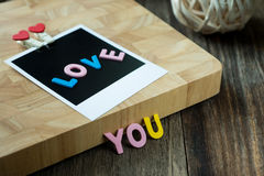 Love you message on Blank instant photo Stock Photo
