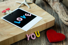 Love you message on Blank instant photo Royalty Free Stock Images