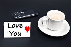 Love you message on desk with coffee Royalty Free Stock Photography