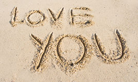 'Love you' message in the sand. stock photo