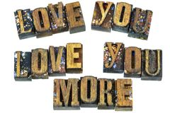Love you more message letterpress. Love you more letterpress do what message motivation greeting block wood letters words Stock Image
