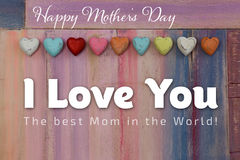 Love You Mothers Day Message Painted Board Hearts. I Love You Happy mothers day message colorful painted board with wooden hearts Royalty Free Stock Photo