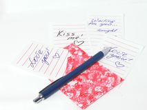 Love You notes. Multiple Love You notes in a pink envelope with a pen Royalty Free Stock Photography