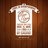 Love you poster in retro style on a wooden backgro Royalty Free Stock Photo