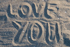 Love you in sand. Love you written in sand Stock Photo