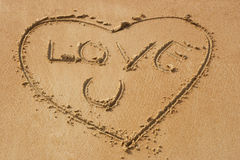 Love you on sandy beach Royalty Free Stock Photos