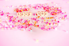 Love you text beads concept Stock Photography