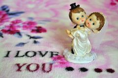 Card love confession. Card with love Valentine's Day or over holiday card to congratulations on wedding happy married little gift small statuette original Royalty Free Stock Photos