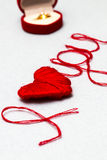 Love you words and heart symbol made of red thread on a white fo Royalty Free Stock Image