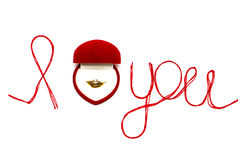 Love you words and heart symbol made of red thread on a white fo Stock Photo