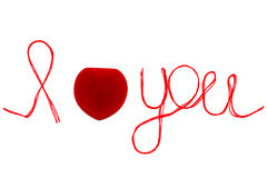 Love you words and heart symbol made of red thread on a white fo Royalty Free Stock Photography