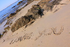 Love you written on the beach. The words love you written in the sand of the beach with the ocean on the background Stock Photos