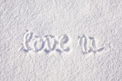 Love you written by hand in the snow Stock Photo