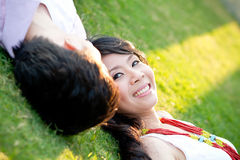An in love young couple. Is relaxing near each others Stock Image