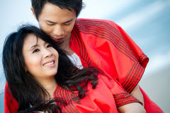 An in love young couple. In romantic emotion with similar red dress Royalty Free Stock Photography