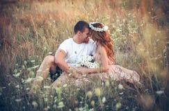 Love between a young couple Stock Photos