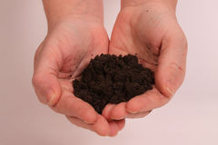 Love your earth. Two hands shaped like a heart holding dirt on a white background stock photography