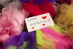 Love yourself. Notepad on a pile of tulle skirts royalty free stock photography