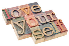 Love yourself in wood type. Love yourself - self esteem concept - isolated text in vintage letterpress wood type printing blocks Stock Photo