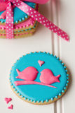 Lovebird cookies. Tied with a ribbon Stock Photos