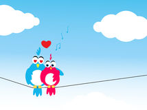 Lovebirds. A pair of lovebirds on a sunny day with happy musical notes, love is in the air theme Stock Image