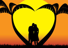 In Loved Couple. In love couple contemplating sunset below heart shaped palm trees Stock Images
