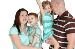 Loveing Family. Happy family of four with one boy and one girl. Loving expressions of closeness with parents and kids stock photo