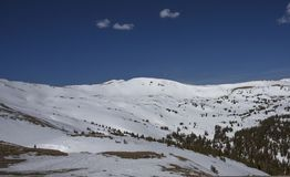 Loveland Pass Colorado mountain slopes. The slopes of the Loveland Pass in Colorado, with a hiker in the foreground stock photography