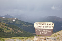Loveland Pass - continental divide. A sign at Loveland Pass and continental divide in Colorado Rocky Mountains - a summer cloudy and foggy day stock images